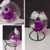 Bola de cristal decorativa con rosa preservada